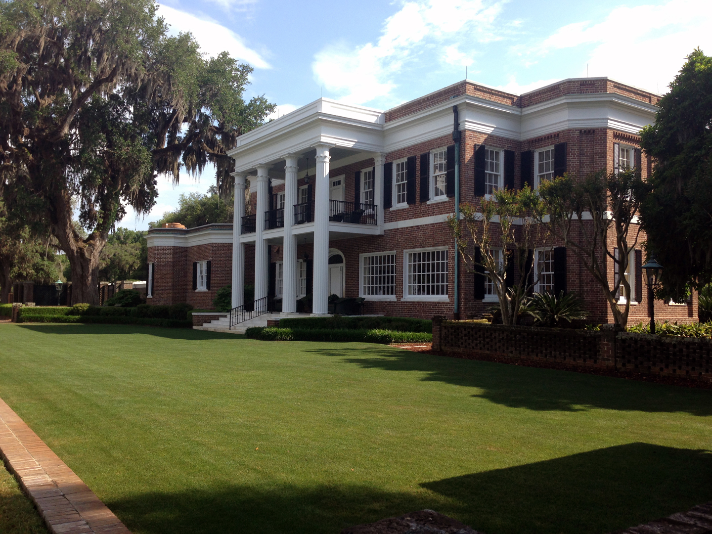 In the early 1920s, a stranger from Michigan unexpectedly appeared. Industrialist Henry Ford purchased massive amounts of land in the area. He eventually accumulated 70,000 acres, covering 120 square miles. In 1936, Ford broke ground for a beautiful Greek revival style mansion on the banks of the Ogeechee River. The grand house, made of Savannah-gray brick, had marble steps, air conditioning and an elevator. It sat on 55 acres of manicured lawns and flowering gardens. The house became the center of social gatherings with visitations by Vanderbilts, Rockefellers and DuPonts. It remains the centerpiece of The Ford Plantation today.