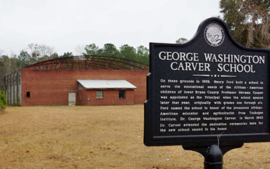 On these grounds in 1939, Henry Ford built a school to serve the educational needs of the African-American children of lower Bryan County. Professor Herman Cooper was appointed as the Principal when the school opened later that year, originally with grades one through six. Ford named the school in honor of the prominent African-American educator and agriculturist from Tuskegee Institute, Dr. George Washington Carver. In March 1940 Dr. Carver attended the dedication ceremonies here for the new school named in his honor.